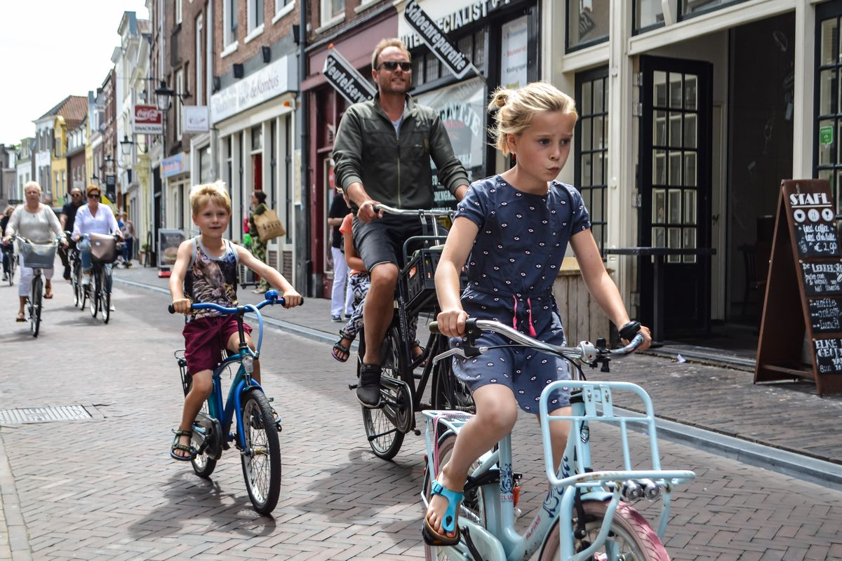 Family Commuting By Bike In Amsterdam