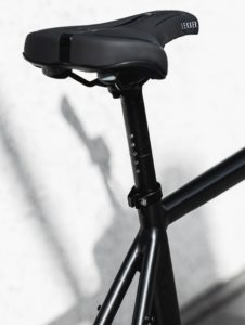 Close up of black bicycle seat