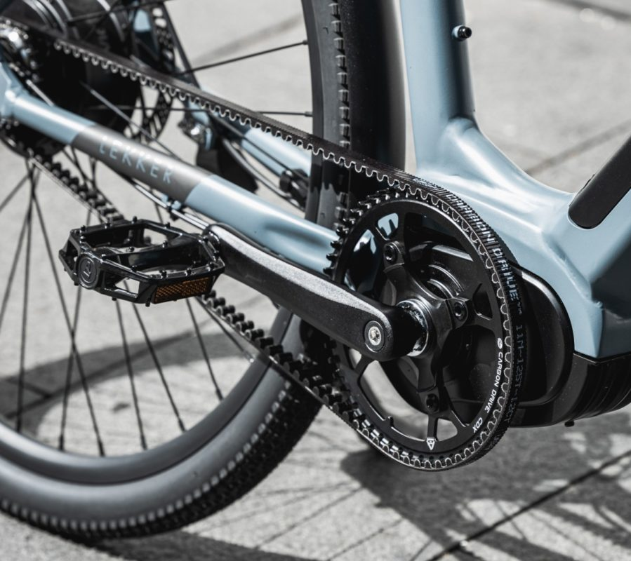 Close up of blue bicycle pedals, tires, and chain